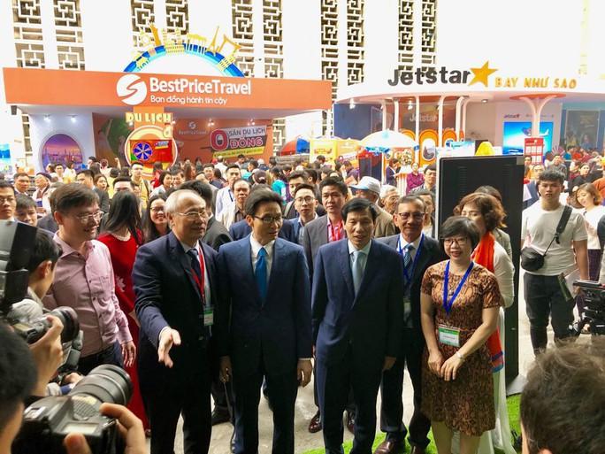 Phó Thủ tướng Vũ Đức Đam khai mạc Hội chợ Du lịch quốc tế VITM Hà Nội 2019 - Ảnh 2.