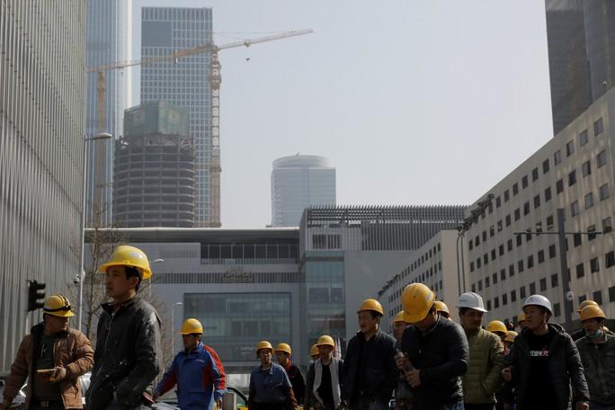 Trung Quốc hạ mục tiêu tăng trưởng kinh tế? - Ảnh 1.
