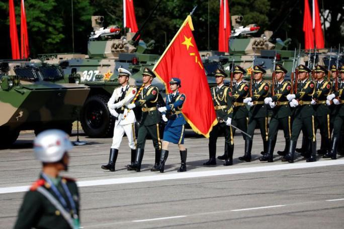 Trung Quốc tăng chi tiêu quốc phòng, hạ mục tiêu tăng trưởng kinh tế - Ảnh 1.
