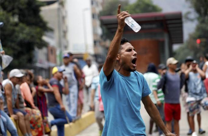 Venezuela: Người dân phóng hỏa gần dinh tổng thống vì mất điện - Ảnh 5.