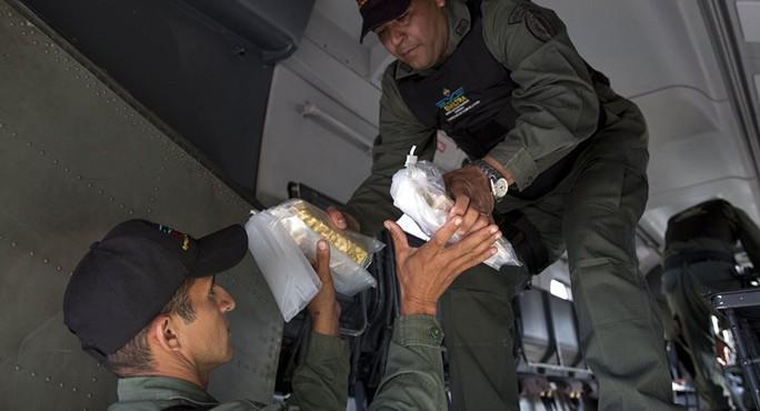 Bị Mỹ gây áp lực, Venezuela âm thầm bán hàng tấn vàng? - Ảnh 1.