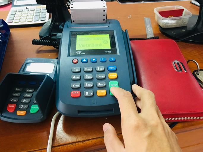 Khuyến khích miễn giảm phí, hoàn tiền khi thanh toán điện, nước, học phí… qua ATM, POS - Ảnh 1.