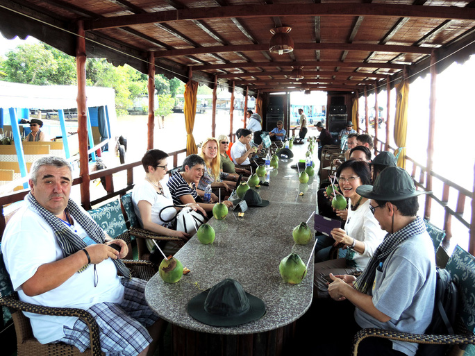 Đẩy mạnh thu hút du khách đến khám phá xứ dừa Bến Tre - Ảnh 1.
