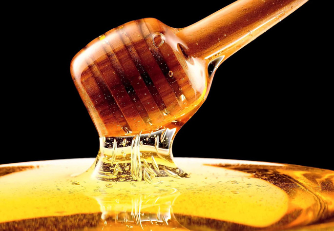 Tác dụng bất ngờ của mật ong lên bệnh tình dục phổ biến - Ảnh 1.