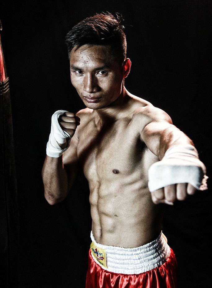 Nguyễn Văn Hải tranh đai vô địch IBO với võ sĩ Trung Quốc - Ảnh 1.