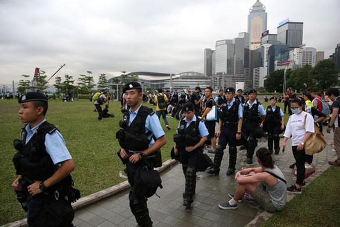 Hồng Kông treo dự luật dẫn độ sau biểu tình - Ảnh 1.