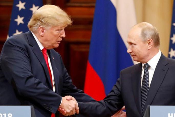 Tổng thống Putin bi quan về quan hệ Nga - Mỹ - Ảnh 1.