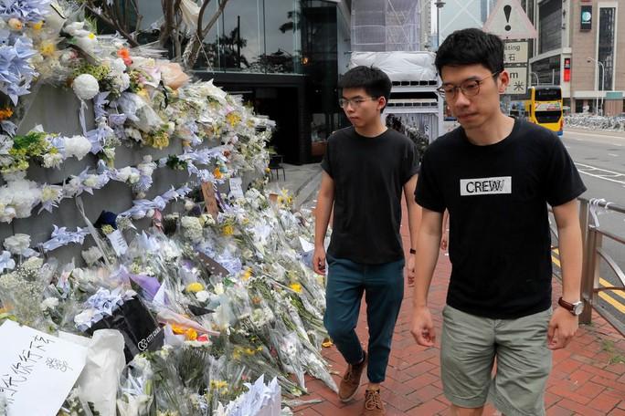 Vừa ra tù, thủ lĩnh sinh viên Hồng Kông tuyên bố biểu tình tiếp - Ảnh 1.