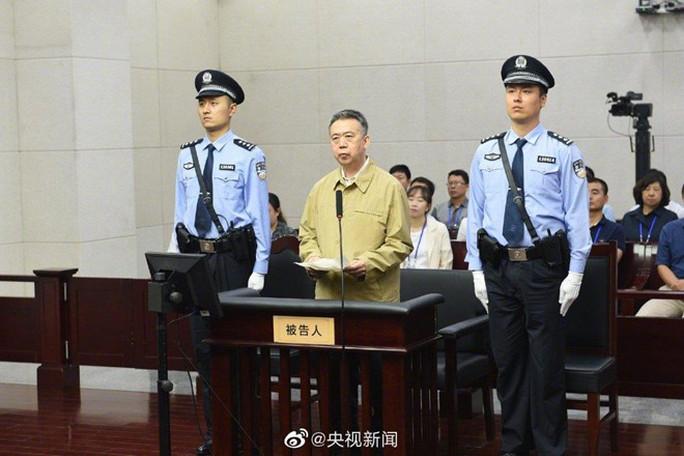 Cựu giám đốc Interpol thừa nhận nhận hối lộ sau thời gian mất tích tại Trung Quốc - Ảnh 1.