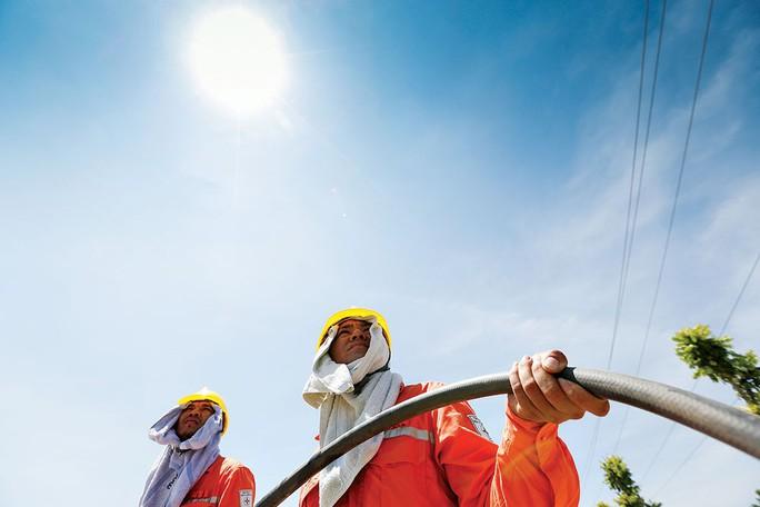 Tiêu thụ điện kỷ lục, EVN khuyến cáo người dân về hóa đơn tiền điện tăng đột biến - Ảnh 1.