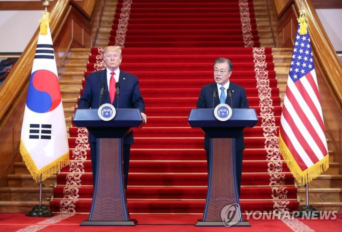 Ông Trump và ông Kim chuẩn bị gặp nhau tại DMZ - Ảnh 1.