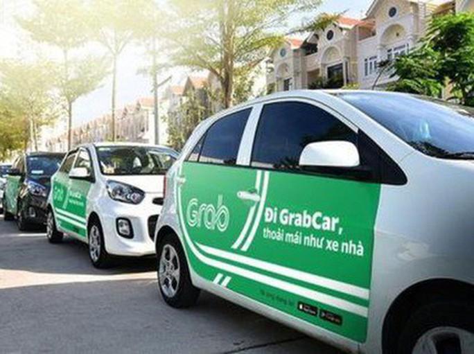 Bộ Giao thông Vận tải vẫn bảo lưu đề xuất Grab phải gắn mào trên nóc xe - Ảnh 1.