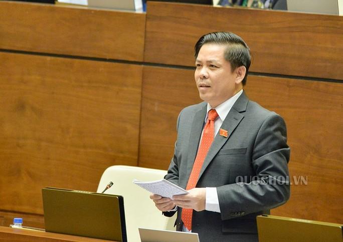 ĐB Nguyễn Hữu Cầu sử dụng quyền tranh luận khi chất vấn Bộ trưởng Nguyễn Văn Thể - Ảnh 1.