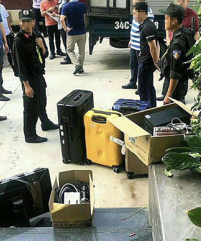 Đột kích sào huyệt nhóm tội phạm công nghệ cao, bắt 22 đối tượng người Trung Quốc - Ảnh 2.