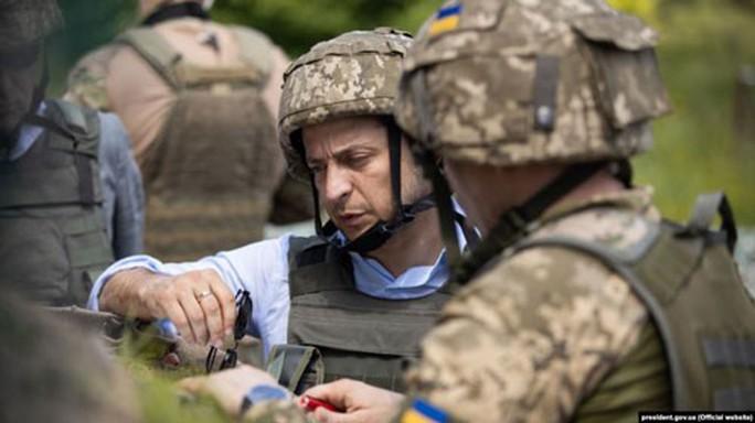 Tân Tổng thống Ukraine muốn gặp ông Putin - Ảnh 1.