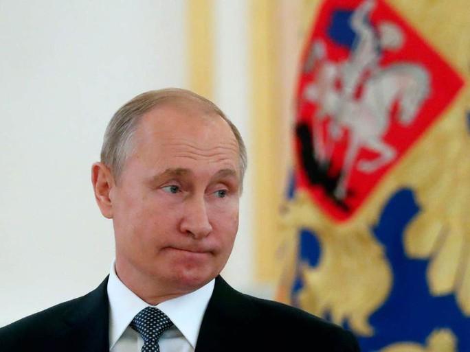 Nga chính thức ngưng tham gia hiệp ước hạt nhân ký với Mỹ - Ảnh 1.