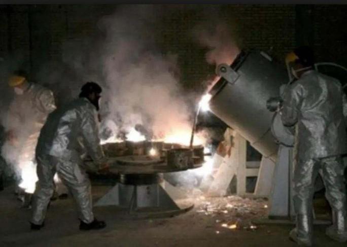 Iran dọa tăng cấp độ làm giàu urani - Ảnh 1.