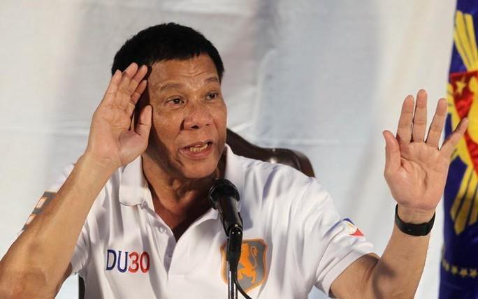 Ông Duterte thách Mỹ tuyên chiến với Trung Quốc trên biển Đông - Ảnh 1.