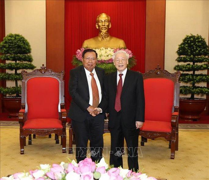 Tổng Bí thư, Chủ tịch nước Nguyễn Phú Trọng tiếp Tổng Bí thư, Chủ tịch nước Lào - Ảnh 1.