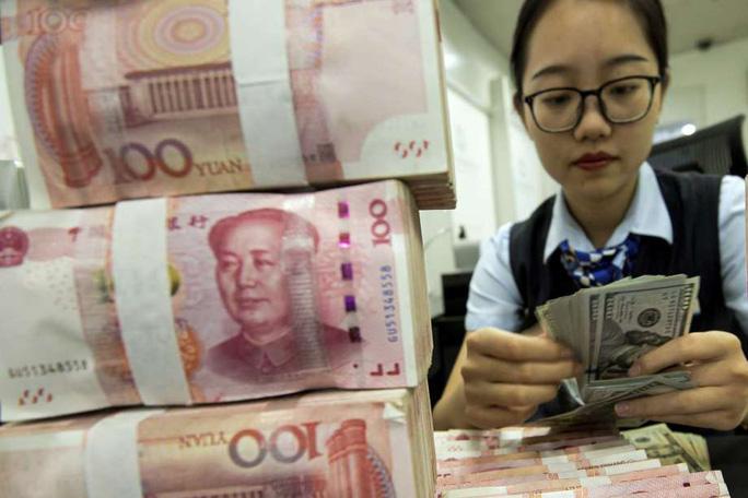 Trung Quốc tiếp tục hạ giá đồng nhân dân tệ - Ảnh 1.