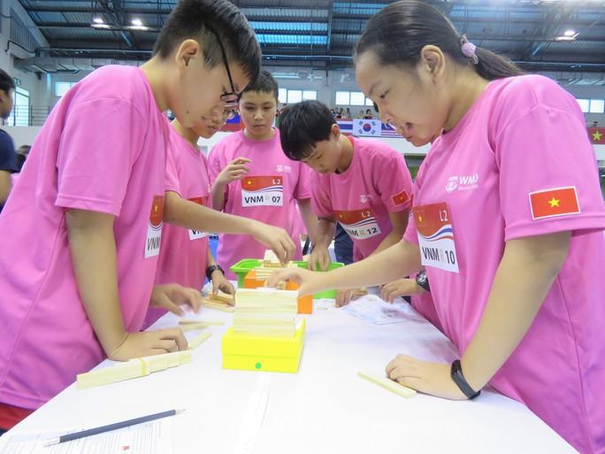 Học sinh Trường THPT chuyên Trần Đại Nghĩa dành 2 HCB cuộc thi toán thế giới - Ảnh 2.