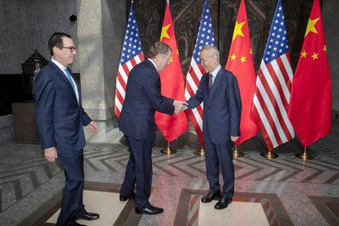 Thấm đòn thương mại, Mỹ nhượng bộ Trung Quốc? - Ảnh 1.