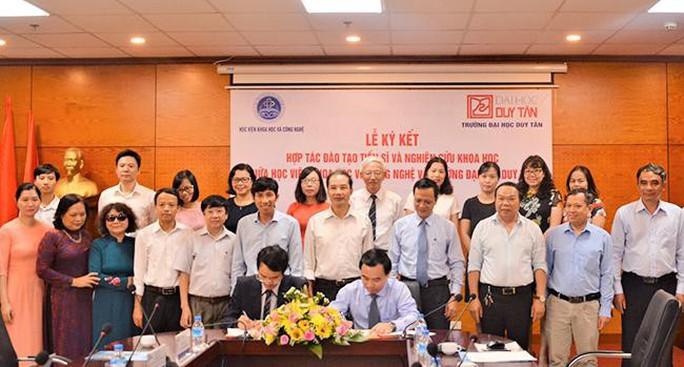 ĐH Duy Tân hợp tác với Học viện Khoa học và Công nghệ đào tạo tiến sĩ - Ảnh 1.