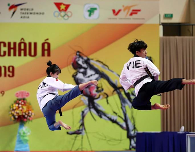 Châu Tuyết Vân cùng đồng đội bay như chim tại giải Vô địch Taekwondo châu Á mở rộng 2019 - Ảnh 4.
