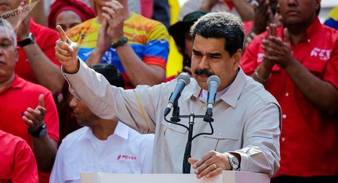 Tổng thống Venezuela so sánh ông Trump với Hitler - Ảnh 1.