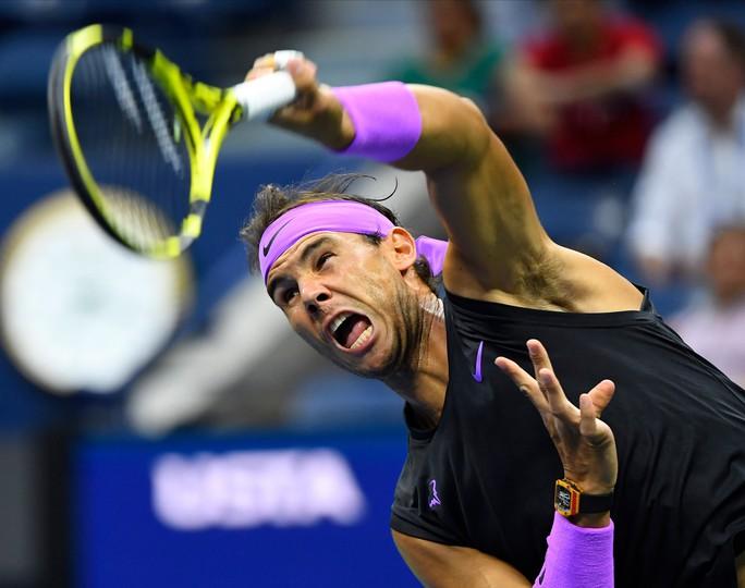 Nadal nhắn nhủ Federer, Djokovic bằng chiến thắng nhẹ ngày ra quân - Ảnh 5.