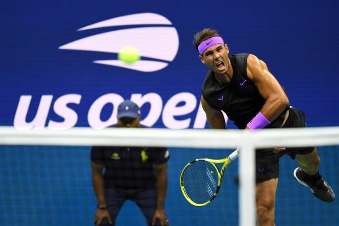Nadal nhắn nhủ Federer, Djokovic bằng chiến thắng nhẹ ngày ra quân - Ảnh 3.