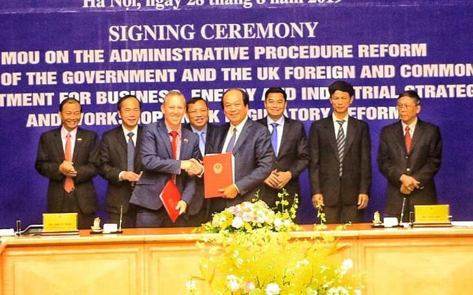Việt Nam cải cách thủ tục hành chính tiếp cận hơn với chuẩn mực OECD - Ảnh 1.