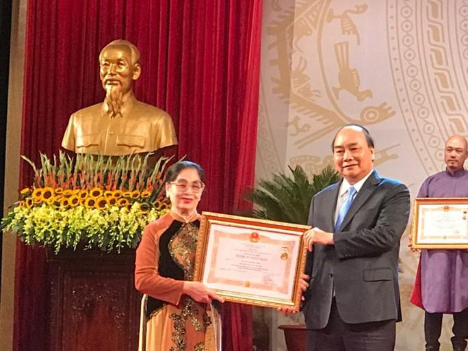 391 nghệ sĩ được trao tặng danh hiệu NSND, NSƯT - Ảnh 10.