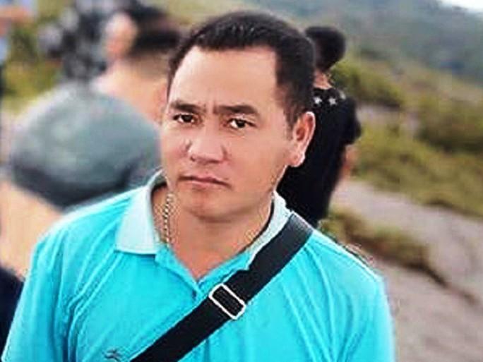 Bộ trưởng Bộ Công an gửi thư chia buồn với gia đình trưởng công an xã tử vong trong mưa lũ - Ảnh 1.
