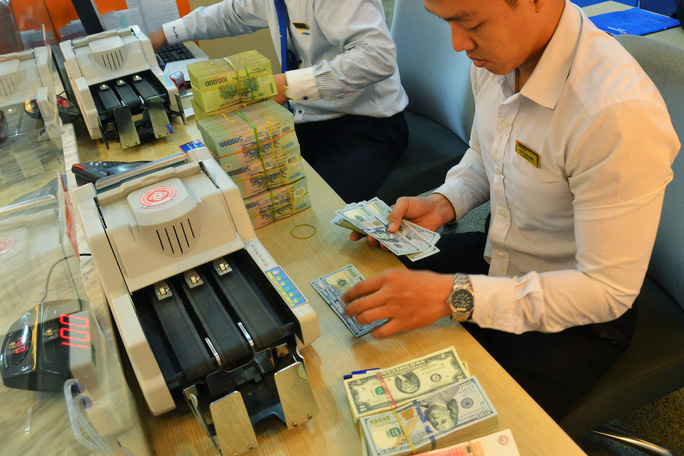 Phòng vệ khi Mỹ - Trung so găng tiền tệ (*): Sức ép lãi suất, tỉ giá không lớn - Ảnh 1.