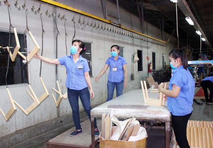 ĐỒNG NAI: Thí điểm ký kết thỏa ước lao động tập thể ngành gỗ - Ảnh 1.
