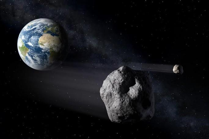 NASA phát hoảng vì tảng đá khổng lồ sắp sượt qua trái đất - Ảnh 2.