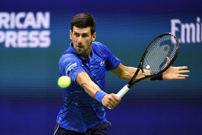 Djokovic thua sốc, sớm bị loại ở vòng 1/8 US Open 2019 - Ảnh 1.