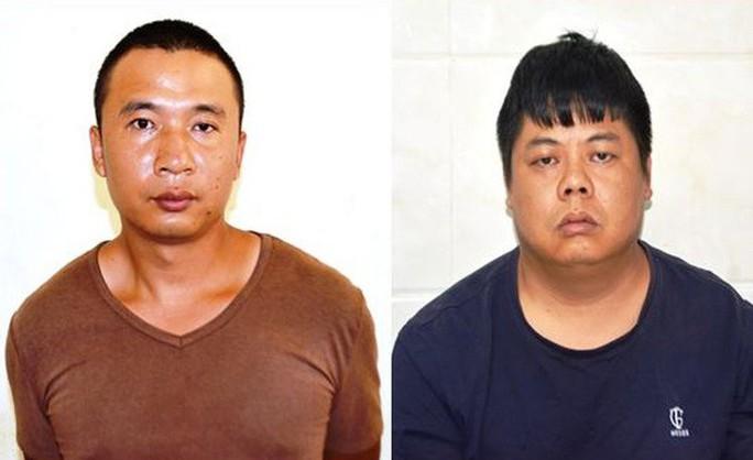 Bắt 3 người Trung Quốc trong vụ cài thiết bị điện tử vào máy ATM để trộm tiền - Ảnh 1.