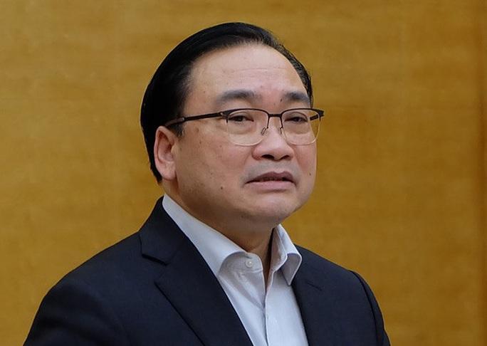 Bộ Chính trị kỷ luật hai ông Hoàng Trung Hải và Triệu Tài Vinh - Ảnh 1.