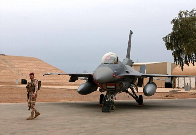 Iraq: Căn cứ không quân bị dội tên lửa, 4 binh sĩ bị thương - Ảnh 1.