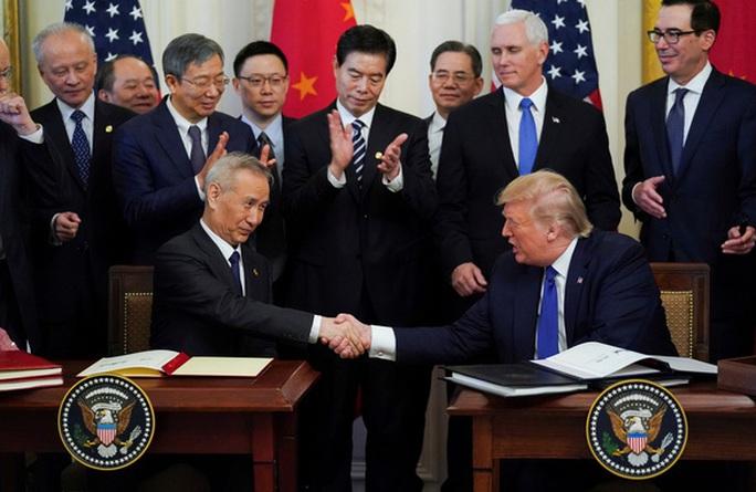 Thỏa thuận thương mại vừa được ký, Chủ tịch Trung Quốc muốn thân thiết với ông Trump  - Ảnh 1.