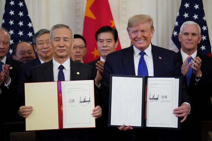 Thỏa thuận thương mại vừa được ký, Chủ tịch Trung Quốc muốn thân thiết với ông Trump  - Ảnh 2.