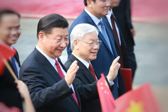 Lãnh đạo Việt Nam trao đổi điện mừng với lãnh đạo Trung Quốc - Ảnh 1.