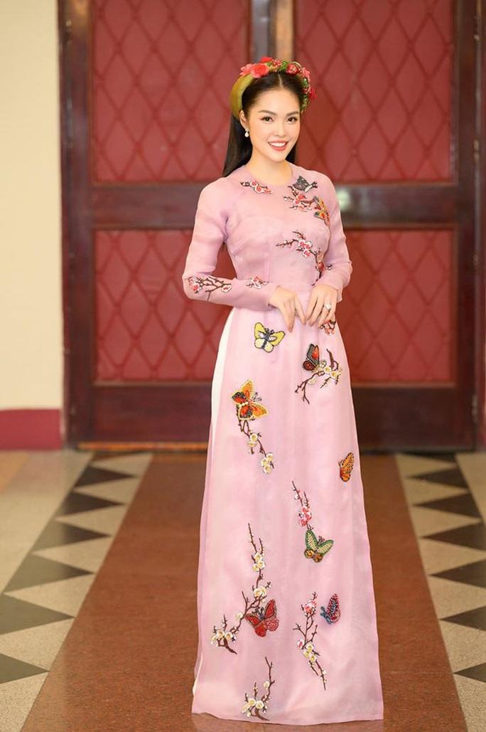 Thướt tha, duyên dáng áo dài du xuân của sao Việt - Ảnh 3.