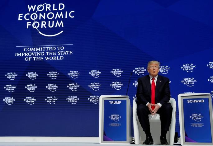 Sóng gió chờ ông Donald Trump ở Davos - Ảnh 1.