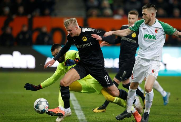 Lập hat-trick ra mắt Dortmund, thần đồng Haaland làm chao đảo Bundesliga - Ảnh 4.