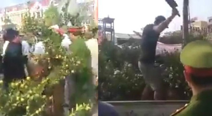 Người đàn ông cầm dao leo lên xe ô tô công vụ chặt các cây quất khi bị xử lý - Ảnh 1.
