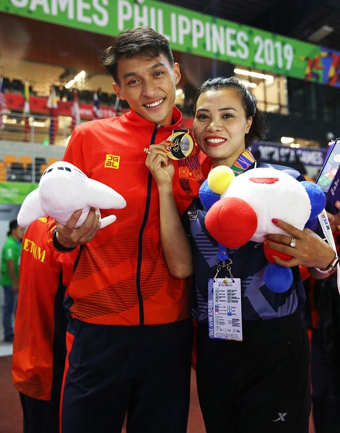 Người múa quạt Trần Nhật Hoàng và hat-trick vàng SEA Games 30 - Ảnh 4.