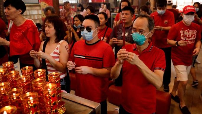 Virus Vũ Hán: Trung Quốc không cho dân ra nước ngoài du lịch - Ảnh 1.